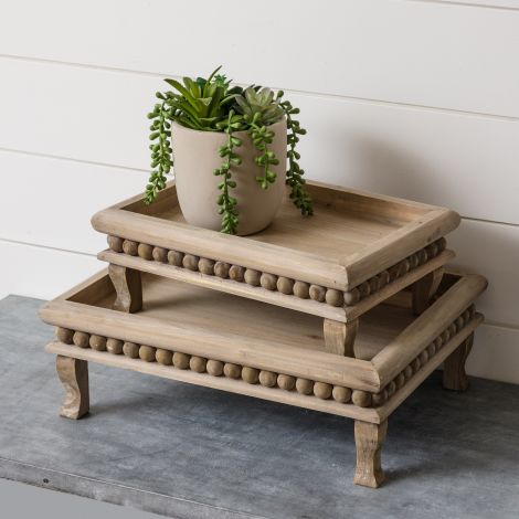 Footed Risers With Beaded Edge